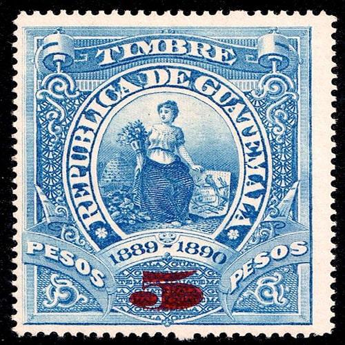 Descripción de la foto - primer timbre de Guatemala en impresión azul una mujer ilustrada con flores, el escudo nacional y el año 1889-1890 crédito de la foto - Del Valle Dental