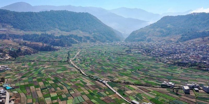 Descripción de foto - Vista aérea de los campos de plantaciones de hortalizas de Almolonga. - Crédito de foto - @chanitoargueta- instagram